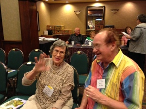 Dorothy Snell & Don Clark with the Seeck crew in the back of the room.